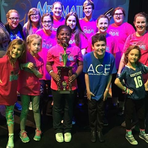 photo of ACE students with Excellence in Ensemble Work Award at Junior Theater Festival