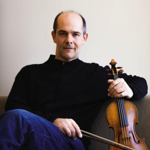 photo of Alexander Kerr seated with violin