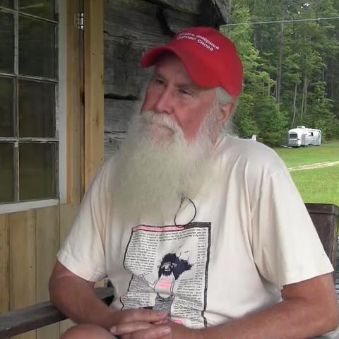 photo of Jim Webb on front porch interviewing on Appalshop