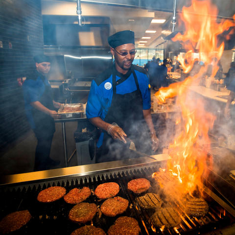 photo of chef grilling hamburgers in Champions Kitchen