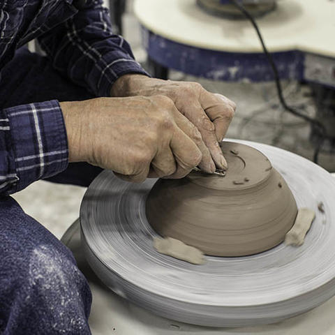 photo of students hands in ceramics course at Fine Arts Institute