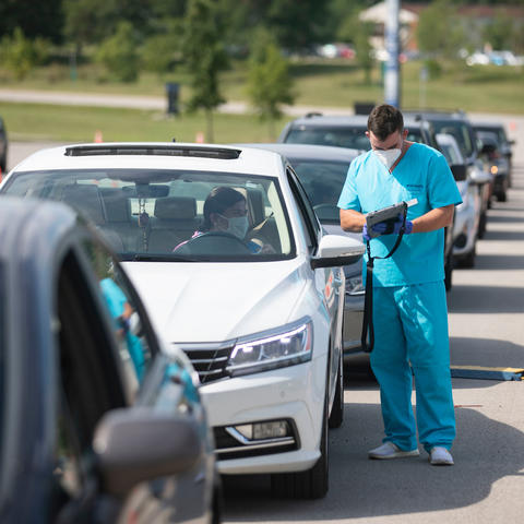 photo of cars in line for people to be tested