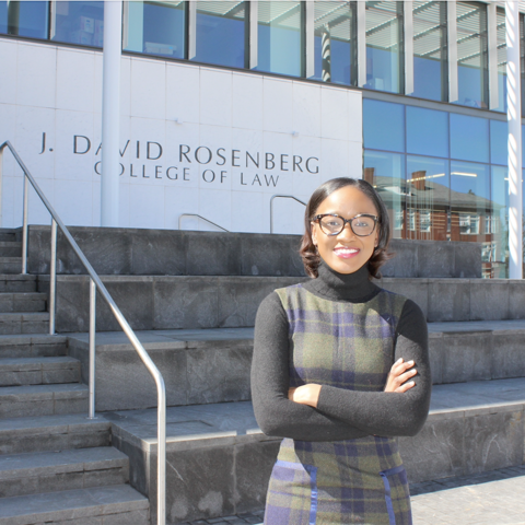 Kelly Daniel pictured in front of Rosenberg Law building on UK's campus