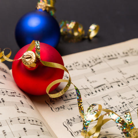 photo of christmas ornaments on sheet music