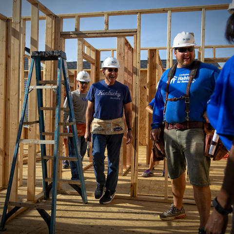 photo showing: Left to Right: Eric Monday, executive vice president for Finance & Administration, UK President Eli Capilouto, Peter Carew, Lexington Habitat for Humanity Director of Construction