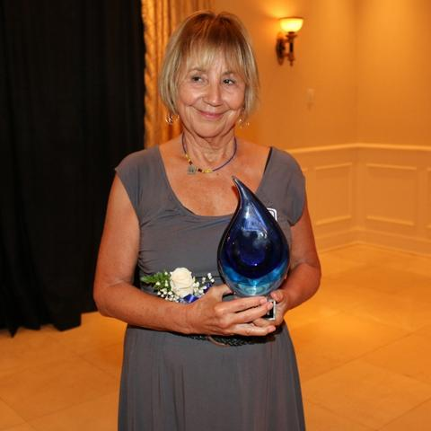 photo of Kay Hoffman with College of Social Work Hall of Fame award