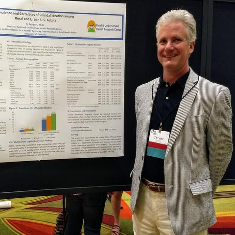 photo of Dr. Ty Borders at a poster presentation