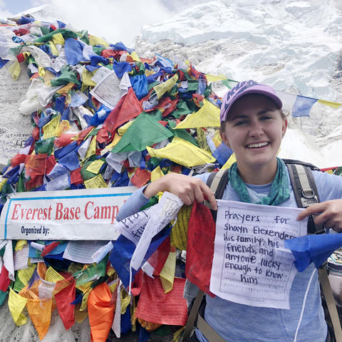 Maya Husayni with prayer flags at Mt. Everest Base Camp