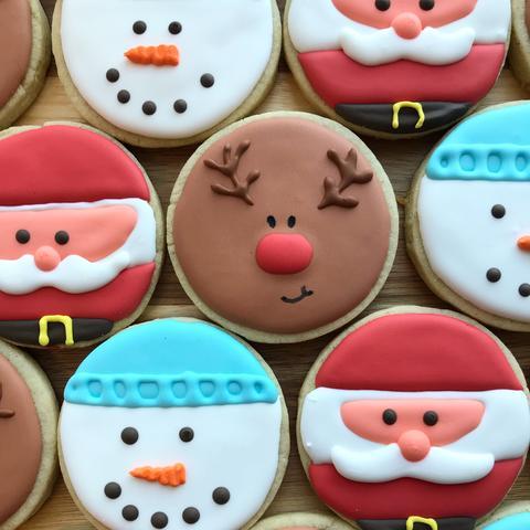 photo of Santa, snowman and reindeer cookies by Daniel King