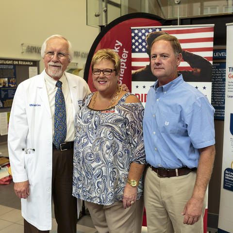 Photo of Dr. Edward Kasarskis, Patricia Peak, and Roddy Williams