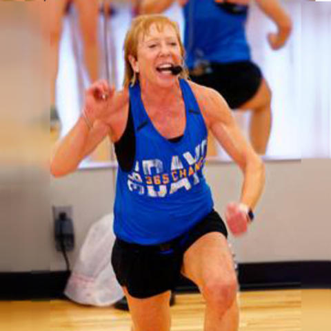 Lisa Hall teaches a fitness class.