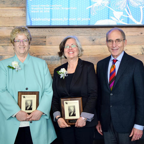 photo of Sarah Bennett Holmes Award winners Debra Moser and Lisa Collins with UK President Eli Capilouto.