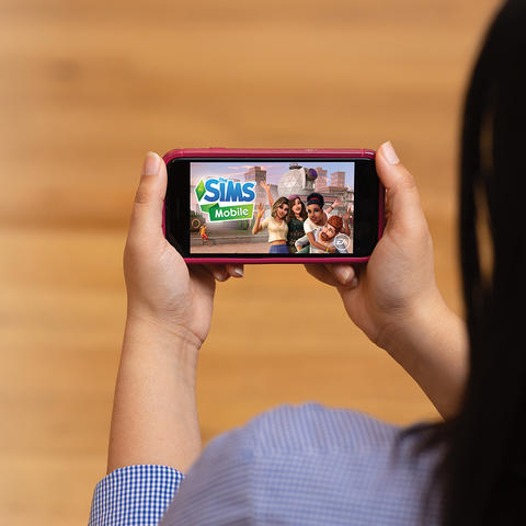 Picture of The Sims on mobile device.