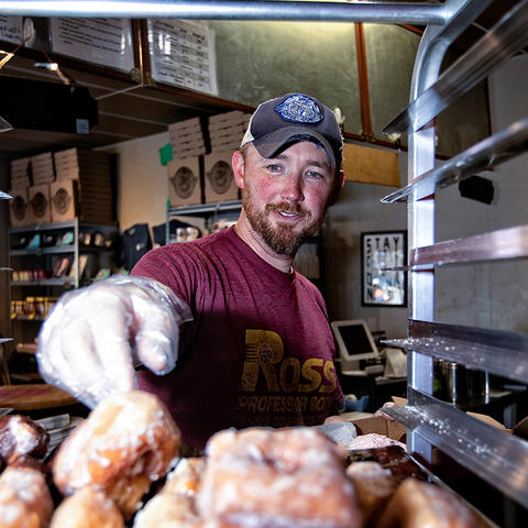 This is a photo of UK alumnus Joe Ross, co-owner of North Lime Coffee and Donuts
