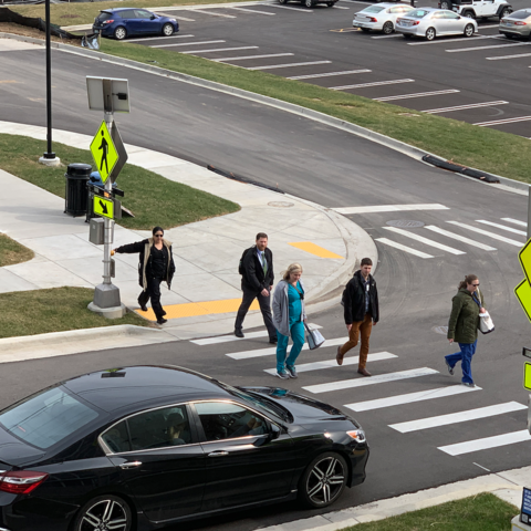 Pedestrians crossing a cross walk.