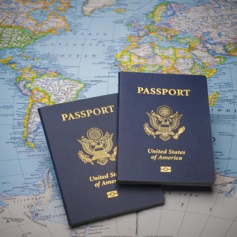 photo of 2 passports on world map