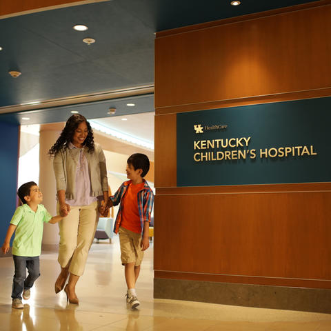 Photo of mother and young children walking out Kentucky Children's Hospital