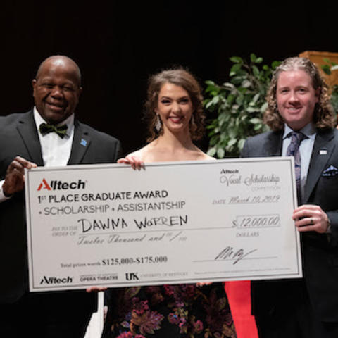 photo of Everett McCorvey, Dawna Warren and Mark Lyons with Dawna's large scholarship check