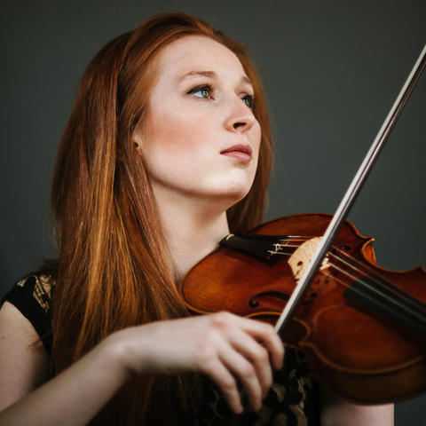 photo of Augusta McKay Lodge with violin and bow