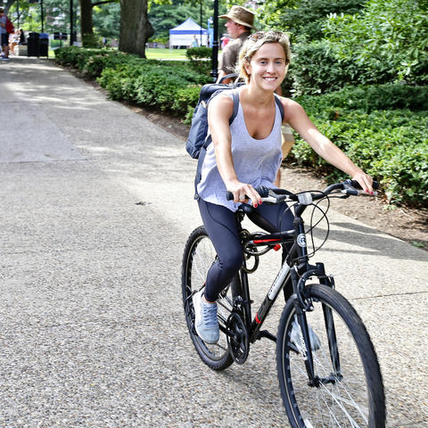 photo of student on bike