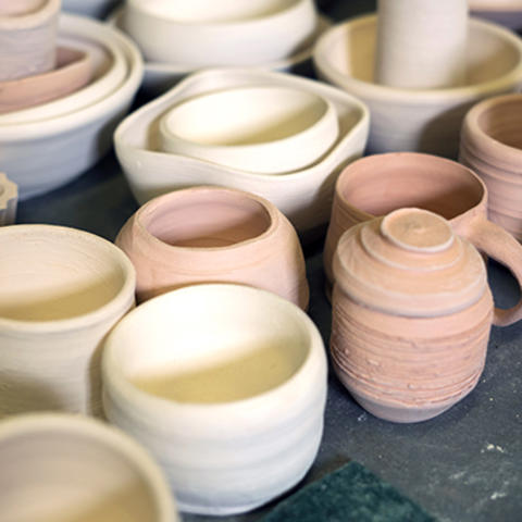 photo of ceramic bowls, mugs, vases