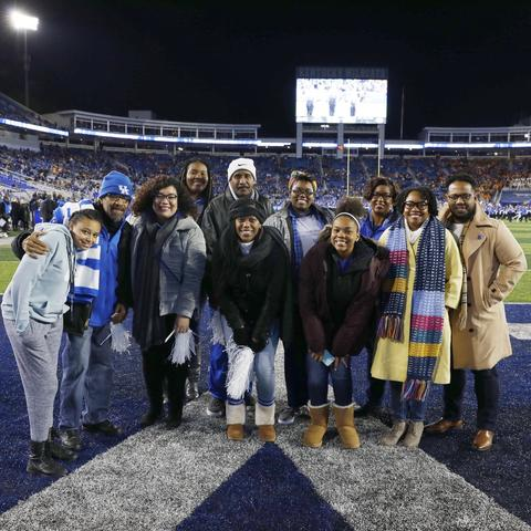 group of Office for Institutional Diversity staff members on Kroger Field at UK football game.