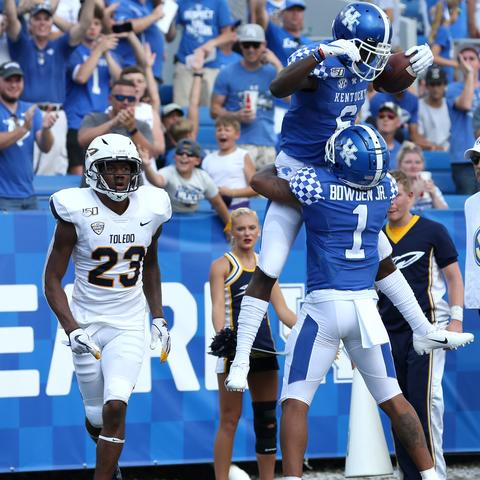 UK football celebrates touchdown over Toledo. UK Athletics | UK Photo.