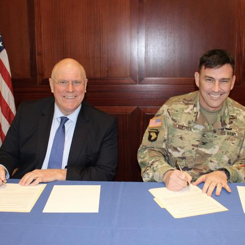 photo of David Blackwell and Col. Joseph Kuchan signing MOU