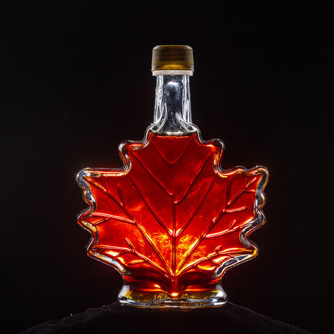 Kentucky maple syrup in a bottle shaped like a maple leaf