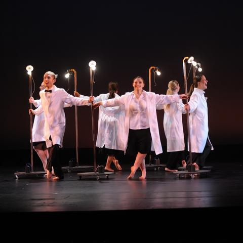 "photo of circle of 6 dancers (including Alyssa Noell Conley) in white coats with light bulbs performing ""Always Carry a Light Bulb"""