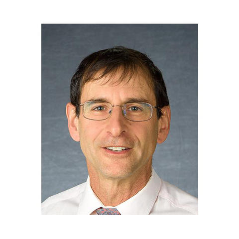 Staff photo of Paul Vincelli in white shirt and glasses