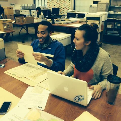 photo of students working with materials in Special Collections Research Center