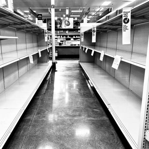 "black and white photo of empty store shelves from ""In This Together"""