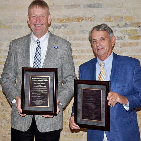 Image of Will Snell (left) and Steve Isaacs (right) holding awards