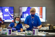 image of two nurses preparing covid vaccines at the UK vaccine clinic