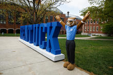 "The UK Wildcat mascot serves as the ""Y"" in large letters spelling ""Kentucky"" near White Hall Classroom Building during ""One Day for UK."" Mark Cornelison and Pete Comparoni 