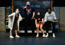 """photo of cast members rehearsing UK Theatre's """"The Thanksgiving Play"""" standing in front of chalkboard"""