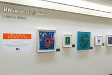 Photo of framed art in employee art gallery