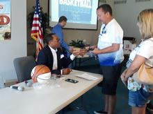 Reggie Hanson meets with fans. Photo by Larry Vaught, courtesy of The Advocate-Messenger