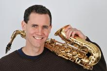 headshot photo of Rick Hirsch with saxophone by Meadowlane Photography
