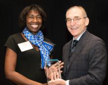 photo of President Capilouto and award winner Sharon Hodge of Social Work
