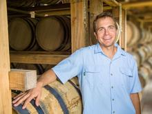 photo of Seth Debolt among bourbon barrels