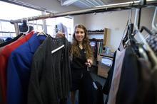 student volunteer working with clothing in Wildcat Wardrobe