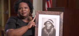 photo of Melynda Price holding black and white photo of her