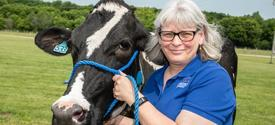 Donna Amaral-Phillips with cow