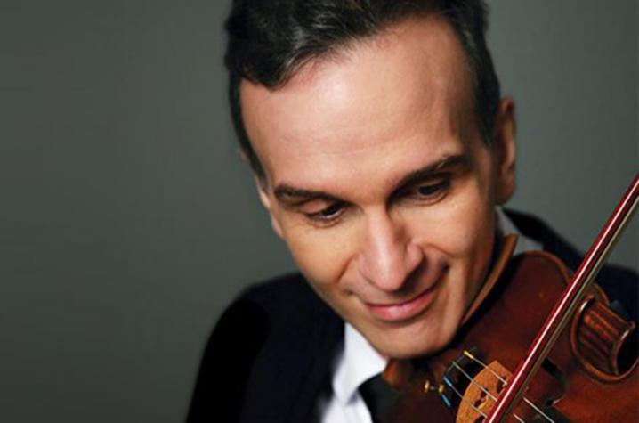 headshot photo of Gil Shaham playing violin