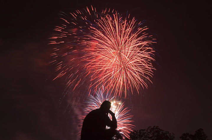 A person watching fireworks.