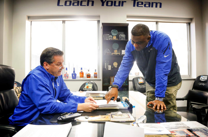 This is a photo of John Calipari (L) and DeWayne Peevy (R).