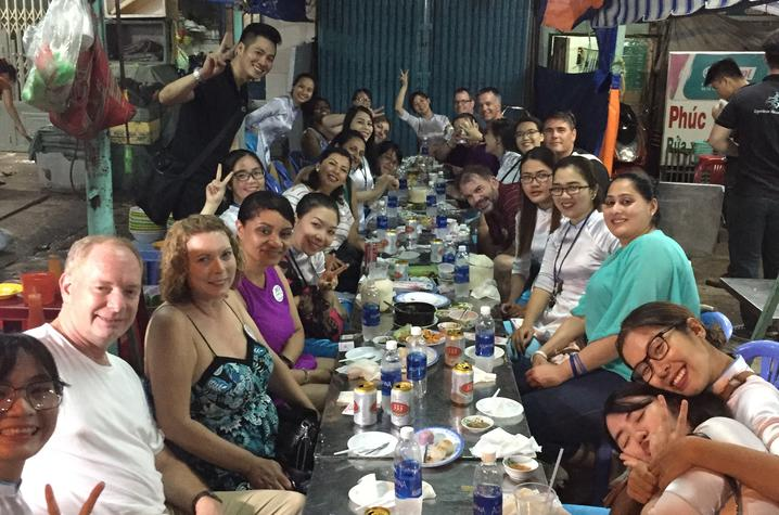 photo of Exec MBA group gathers for an evening meal during trip
