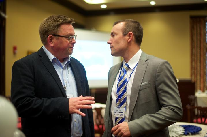 Tom Martin of EKU, left, talks with UK's Ian McClure